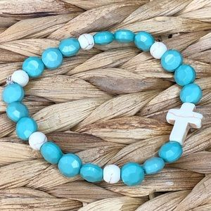 Turquoise/green bracelet with ivory cross.
